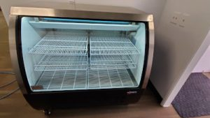 Used OMCAN Curved Glass Display Cooler